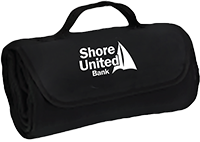 Black roll-up blanket with a white Shore United Bank logo
