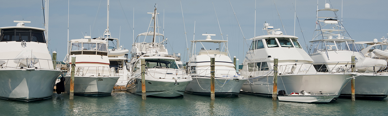 A row of luxury yachts docked in Key West