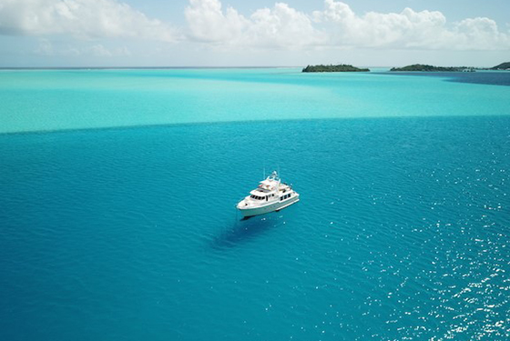 An aerial view of a 50 ft. Nordhavn anchored in the Eastern Lagoon of Bora Bora
