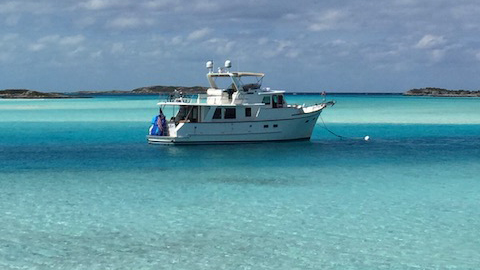 A 2007 DeFever 52' Euro on a mooring ball at Warderick Wells Cay in Exhumas State Park, Bahamas