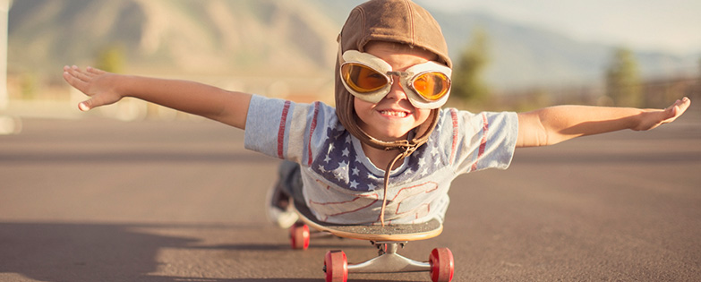 "A boy ""flying"" on a skateboard"