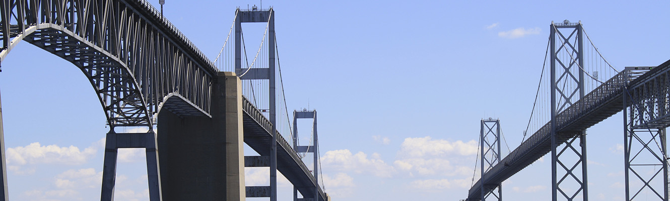 A view of both of the Chesapeake Bay Bridge spans from the water below the bridge