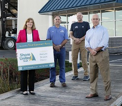 Robin O'Brien, Shore United Bank; Rob Marsh, Kent Narrows Marine LLC;  Jody Schulz, Kent Narrows Marine LLC; and Michael Cavey, Shore United Bank; gather for a picture in front of the Boatel's site as they prepare for Phase ll to begin. (Not pictured:  Jeff Kogok, Kent Narrows Marine LLC)