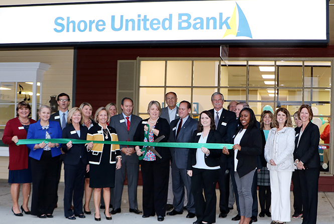 Shore United Bank and chamber representatives gather in front of the Shore United Bank branch in Onley, VA for the official ribbon cutting.