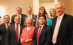 A group of Shore Bancshares employees accepting the Talbot Chamber's Large Business of the Year award in 2018