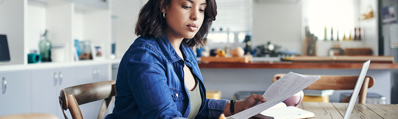 An African American woman doing paper work