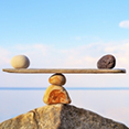 two rocks balancing on beam