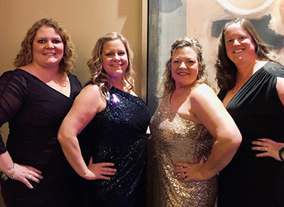 Lora Davis, Heather Bacher, Kerry Nagle, and Stephanie Tyler at the Bosom Buddies Ball in 2019