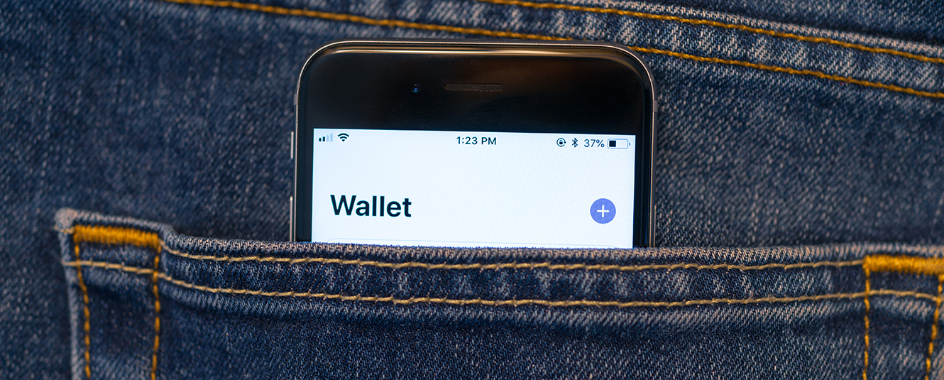 A back pocket with a mobile device in it and a digital wallet on the screen