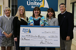 A photo of Shore United Bank employees with TCPS Education Foundation Representatives holding a donation check from Shore United Bank for $1,000