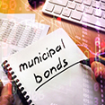A notebook with municipal bonds underlined